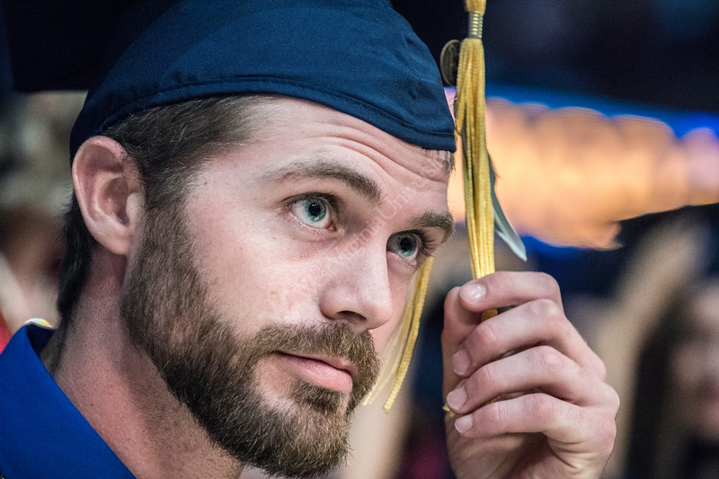 Upon coming to Morgantown Brian Young learned to hunt water fowl and displays a duck feather on his tassle symbolizing his love the sport as he moves it from right to left at the conclusion of the Davis College of Agriculture, Natural Resrouces and Design Commencement in the Coliseum May 11th, 2018.  Photo Brian Persinger