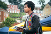 WVU Freshmen Teddy Tesol Eblery College from Kenya listens Gregory Dunaway, Ph.D. Dean of the Eberly College of Arts and Sciences, speak about the future and opportunities at the Academic Session on the Mountainlair Green  August 14, 2017. Photo Greg Ellis