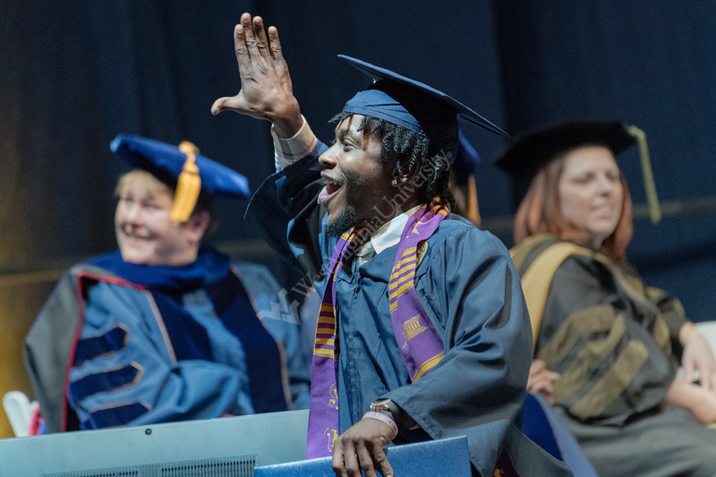 Eblery College graduate Steven Somers waves to family and friends after receiving his diploma May 14, 2017, at the Eblery College Commencement. Photo Greg Ellis