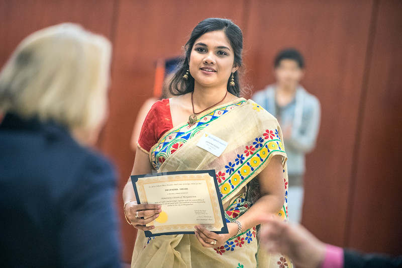 Sriparna Ghosh, receiving a Ph.D. in Economics of India is recognized at the Global Affairs annual International Graduation at the Erickson Alumni Center May 11th, 2017.  Photo Brian Persinger