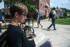 "Exercise Physiology major Luke Litvinov reads, ""The Book of Five Rings"" outside Woodburn Hall during the first day of class on the downtown campus August 15th, 2018.  Photo Brian Persinger"