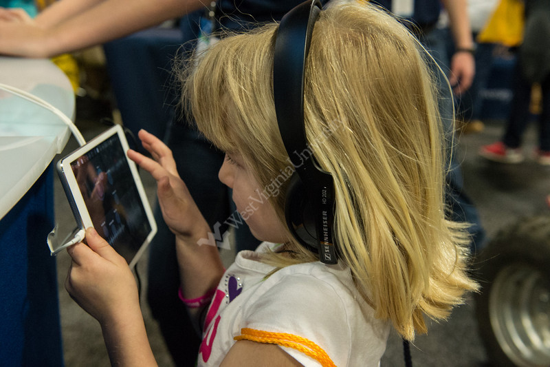Visitors learning about pulsars with iPad apps in the exhibit's radio astronomy display.