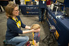 WVU Extension faculty member Jen Robertson-Honecker steadies a boy's head for an iris scan.
