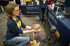 WVU Extension faculty member Jen Robertson-Honecker steadies a boy's head for an iris scan.