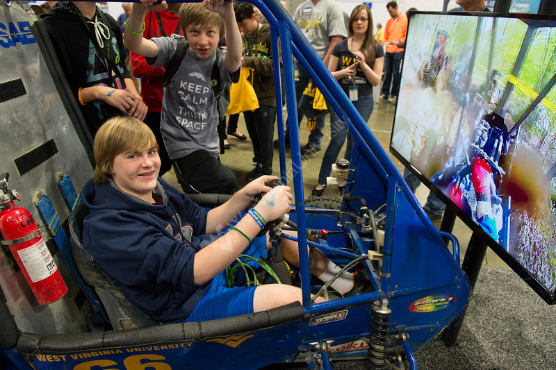 Visitors to the WVU exhibit got to jump into a real competition Mini Baja car and experience the competition.