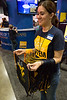 Radio astronomy student Rossina Miller gives out WVU cinch sacks.