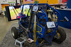 """The Mini-Baja Car Competition display featured a driver's eye view video in front, and iPad apps that let people make design decisions while """"building"""" their own Baja car."""