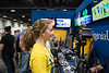 Visitors to the WVU booth have their irises scanned and are given prints.