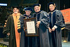 L to R Gene Cilento  Glen H. Hiner Dean of the Statler College of Engineering and Mineral Resources, E. Gordon Gee President of WVU presents an Honorary Doctorate of Letters to Joseph Wayne Richards President, CEO GR Energy Services and Mattew Valenti Chair, WVU Faculty Senate. At the  Statler College of Engineering and Mineral Resources Commencement May 12, 2018. Photo Greg Ellis
