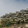 Stacked Stone Wall with Cloudy Background