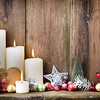 Christmas Advent candles with festive decor.