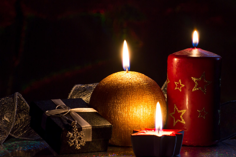 Christmas decoration with candles and gift wrapping
