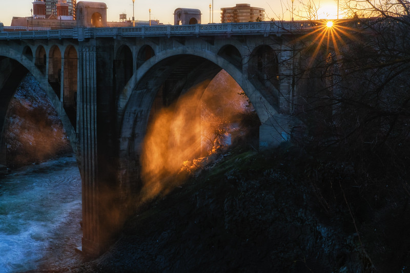 Sun shining through steam under the Monroe Street Bridge in Spokane