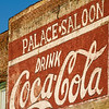 Sign advertising the Palace Saloon on the side of a building in the historic district of Fernandina Beach in Florida.
