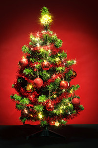 Decorated christmas tree with stars on red background