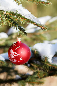 christmas balls on outdoor snowy tree