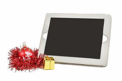 gift white tablet with Christmas ball, box and red chain