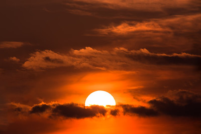 sunset with sun over clouds