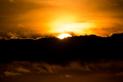 sunset with sun clouds over clouds