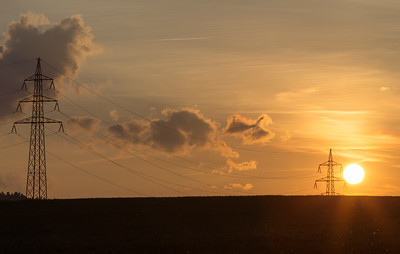 summer sunset with electricity tower