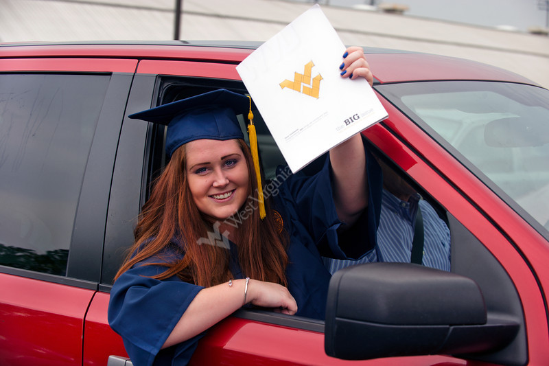 28343s0263xx Alyssa Boley an English major of Charleston, Wv displays her WV Alumni Magazine as she leaves the Coliseum following the Eberly Commencement Sunday May 13th, 2012.