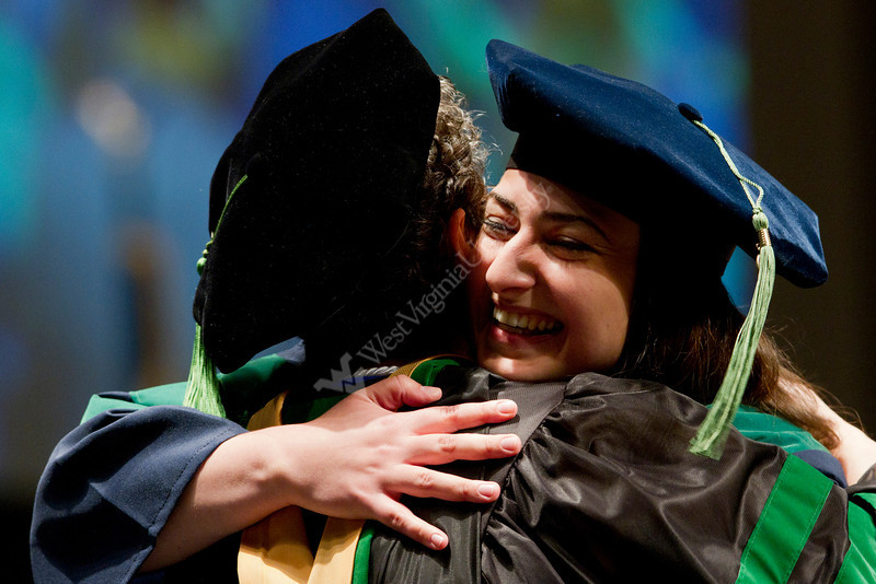 Neurology specialist Diana Mnatsakanova hugs a faculty member after receiving her diploma at the WVU School of Medicine's 2012 Commencement ceremony.