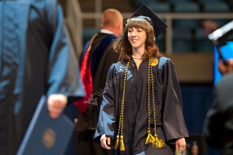 28339z063xx<br /> Graduating magna cum laude with a degree in Animal and Nutritional Sciences, Megan Grzeskiewicz walks across the stage during the Davis College ceremony.