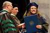 Andrea Amos accepts her diploma at the WVU School of Pharmacy's 2012 commencement ceremony.