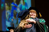 Physician Anne Cather hugs student Ann Marie Deadrick at the WVU School of Medicine's 2012 Commencement ceremony.