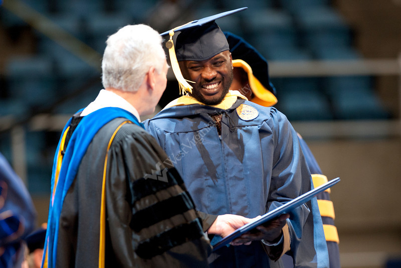 28339s053xx<br /> Sulaiman Olawele Balogun, a Nigeria native, laughs afters receiving his masters degree in Agriculture and Resource Economics during the Davis College commencement ceremony.