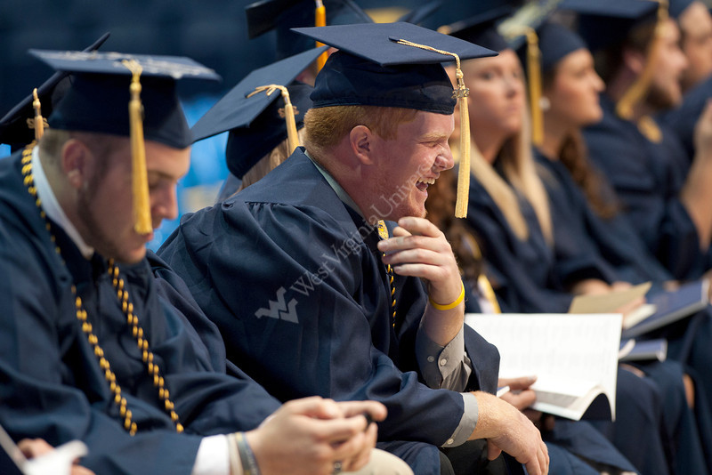 28339s081xx<br /> Eric Rhodes, an Agribusiness Management and Rural Development major from Ripley, WV< laughs with his friends during the Davis College commencement ceremony.