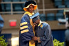 28339s049xx<br /> Sulaiman Olawele Balogun, a Nigeria native, laughs with his advisor after being hooded for receiving his masters degree in Agriculture and Resource Economics.