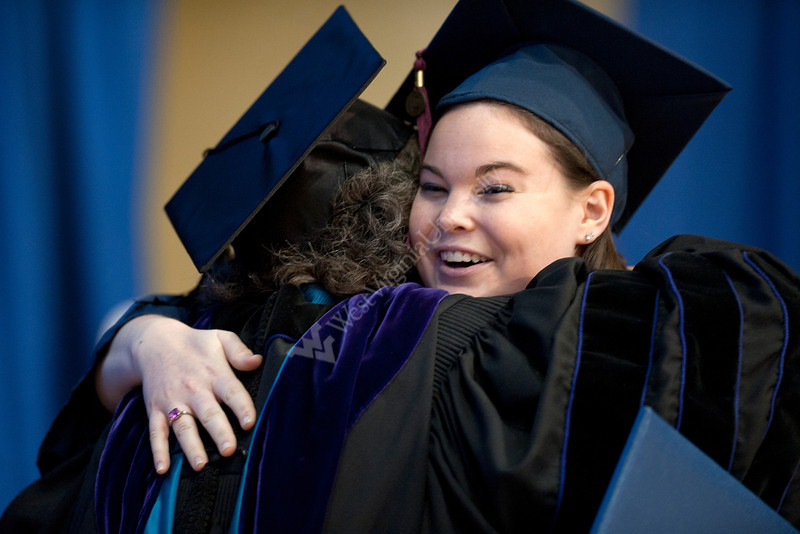 28339z084xx<br /> Ashley Hardt, an Interior Design Major from Centreville, VA, celebrates with a professor after receiveing her diploma during the Davis College commencement ceremony.