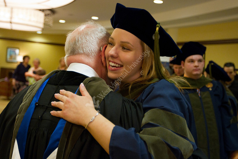Katie Kacmarik hugs Professor Arthur Jacknowitz at the end of the WVU School of Pharmacy's 2012 commencement.