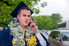 "28343s0398xx  Kyle Erpenbach an Econ major of Baltimore, Md tries to locate his family outside the Coliseum following the Eberly Commencement Sunday May 13th, 2012.  His mother gave him the ""Money Lei"" so she would be able to see him easily."