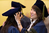 Tracy Tran, right, helps friend Dao Luu with her cap prior to the commencement ceremony for the School of Pharmacy.
