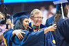 30438; s0615xx; 30438; december commencement; 2014; photo greg ellis; l to r melanie nieto multi disciplinary studies balttimore maryland; e gordon gee; campus scene; selfie
