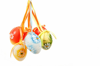 hanged bright color easter eggs with bows