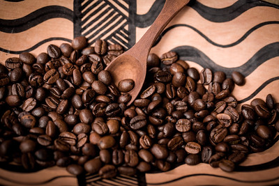 pile of fresh and bio aromatic coffee beans and spoon