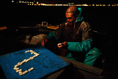 Victor Andrews (age 47, years fishing 28, skipper and crew) plays game to pass the time on three hour leg from Kalk Bay Harbor to fishing location, on board Kalky's 5.