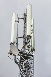Wireless communication tower with antenna