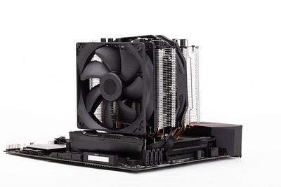 computer PC mainboard with CPU cooler on white