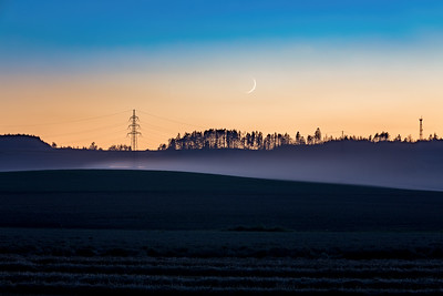 countryside landscape after sunset with moon