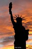 Loveland's Lady Liberty in silhouette.