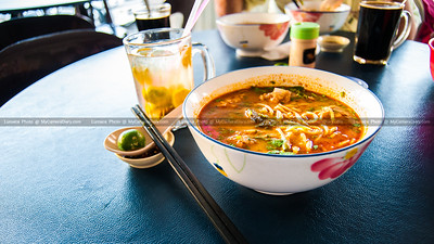 A Bowl Of Spicy Seafood Laksa Noodles Soup