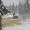 I couldn't resist.  This is my dad.  His sled broke through the ice and he was soaked up to his thighs.  We had a heck of a time getting the sled out.  <br /> <br /> Much to his chagrin, I've used this photo many times to create greeting cards regarding men and their failure to read the signs.