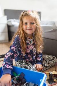 Smiling cute girl with long curly golden hair