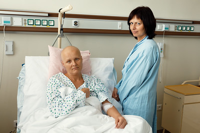 woman patient with cancer in hospital with friend