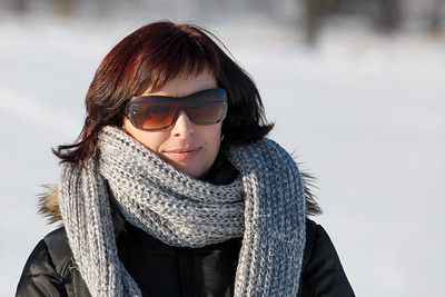 woman with sunglasses without makeup in winter time
