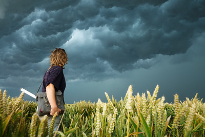 University of Groningen researcher Almut Schlaich faces a thunderstorm in the field. Groningen, the Netherlands.
